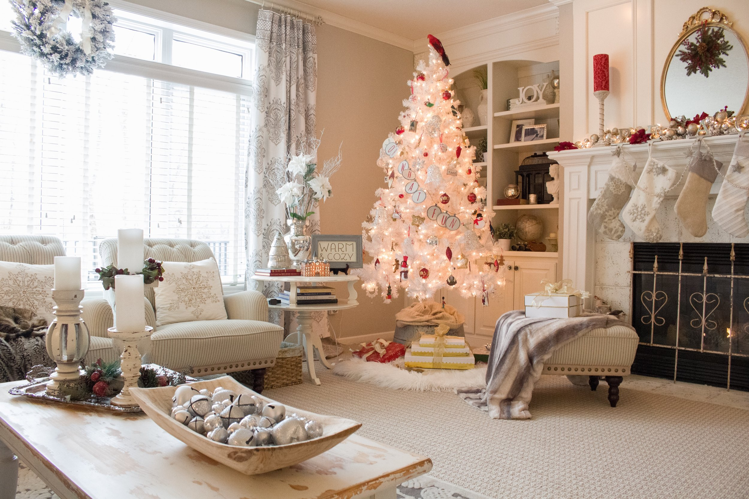 we decorated the white tree simply with all of our family ornaments collected over the years they range from babys first christmas to school made - At Home Store Christmas Decorations